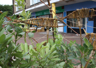 Willow Fish in Straw Bale Planters